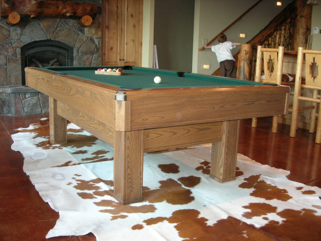 Cowhide rug under pool table