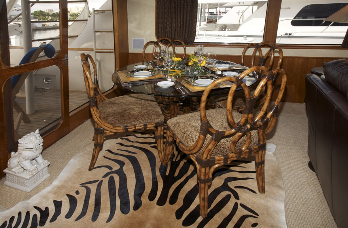 Exotic cowhide rug pattern under table