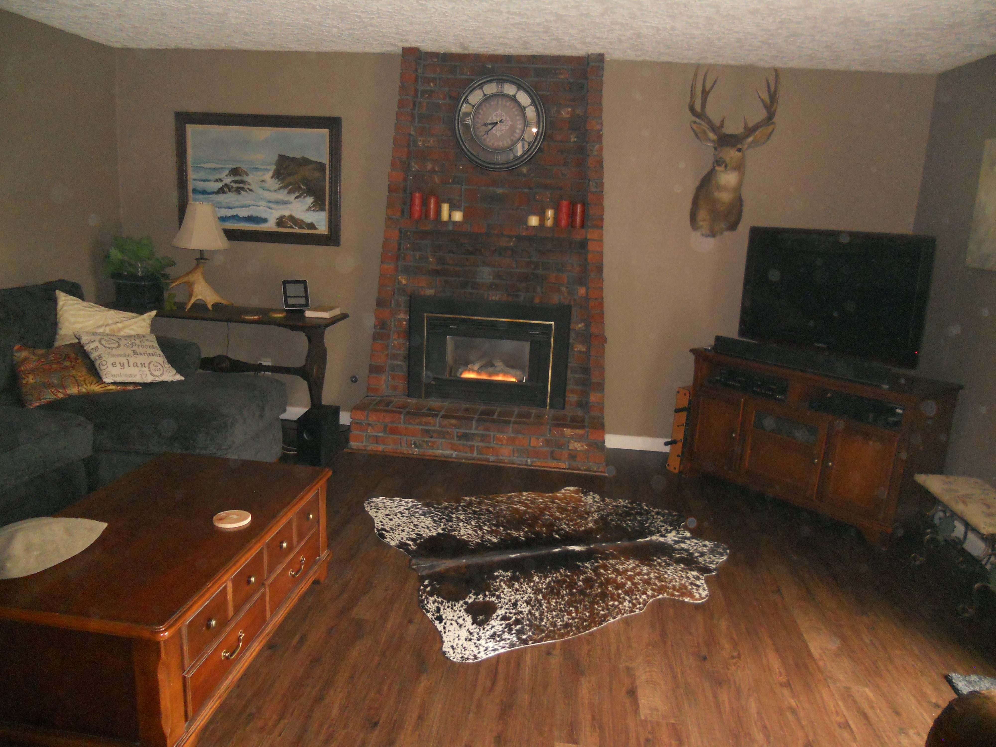 Cowhide rug near fireplace