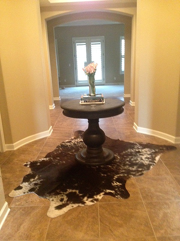 Cowhide rug on tile floor