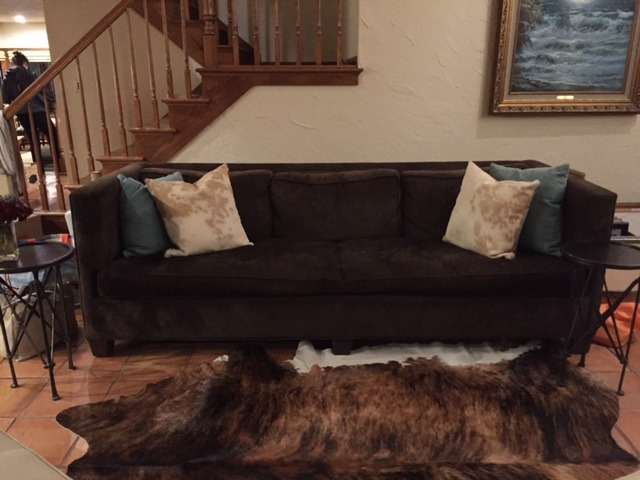 Cowhide rug with dark couch