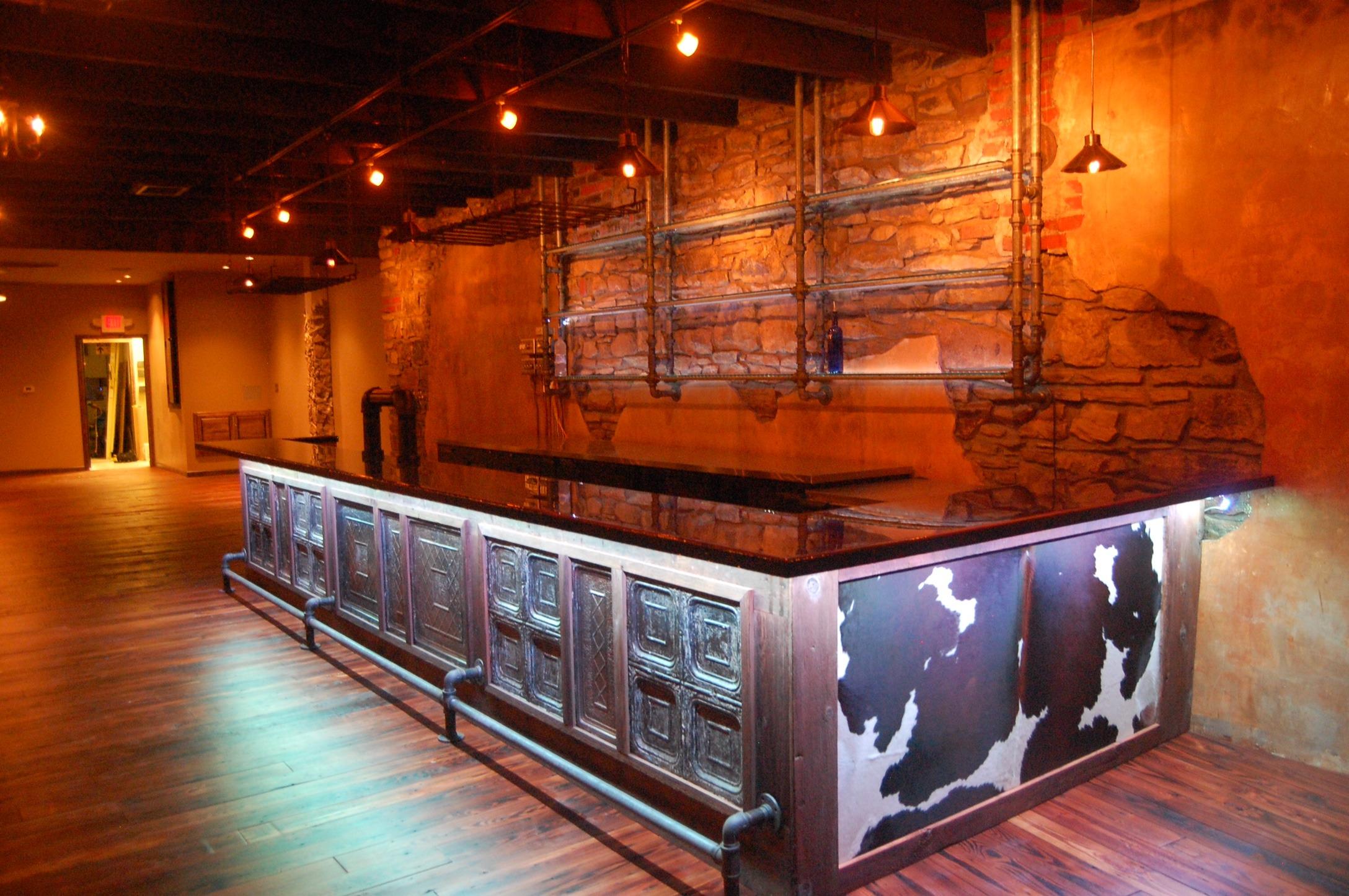 Cowhide rug on bar