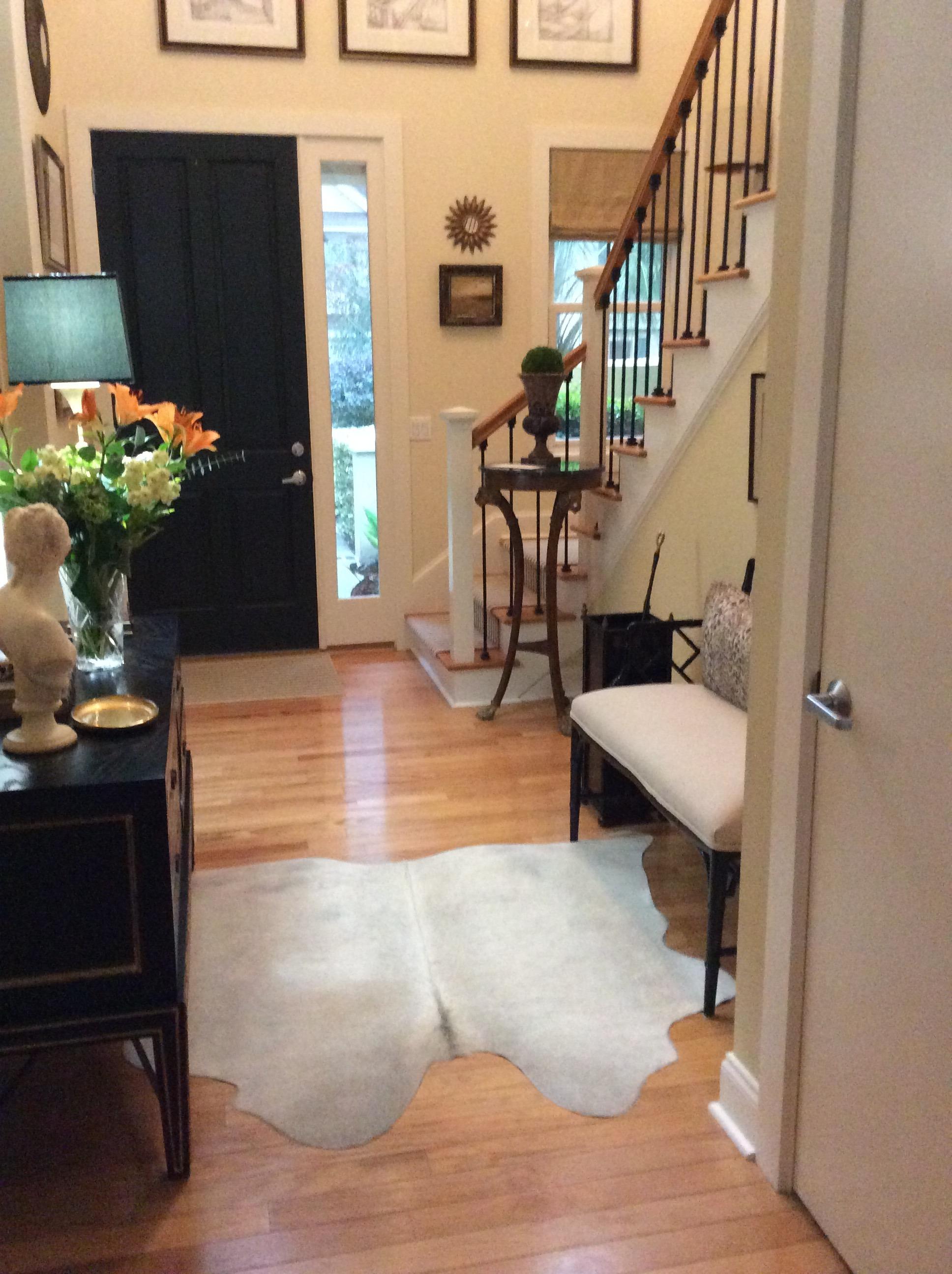 Cowhide rug in entry